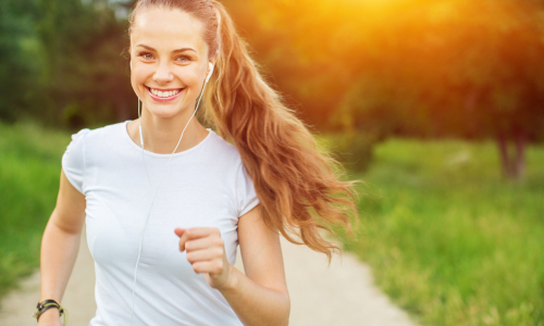 Woman speed walking using proper posture