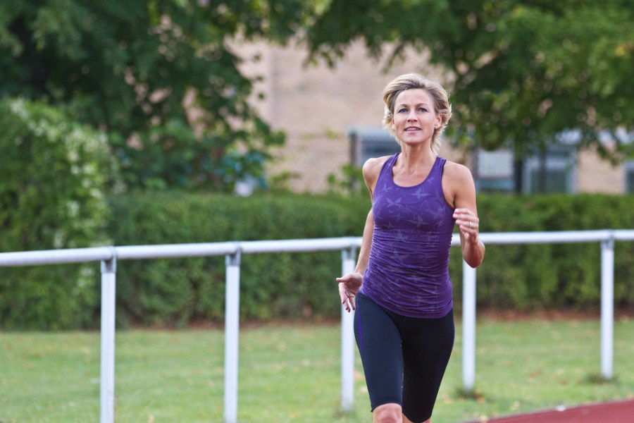 Woman speed walking on a walking track