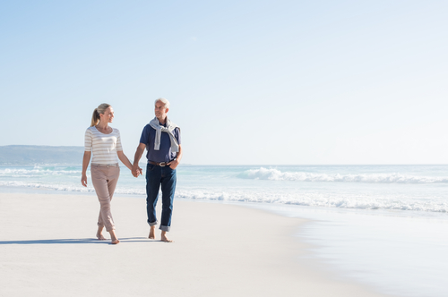 Older couple going for a leisurely walk on the beach