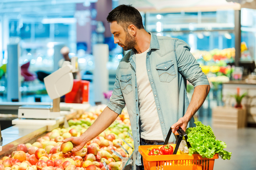 Man choosing healthy fruits and vegetables