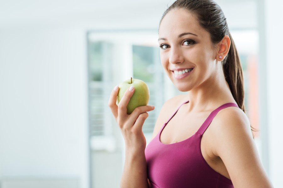 Woman eating an apple healthy lifestyle concept