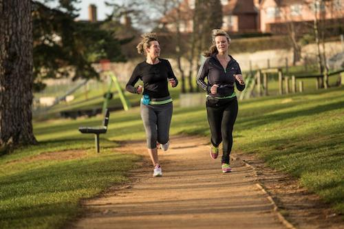 Women running with running buddy pouches