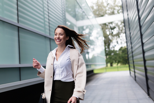 Businesswoman walking between buildings