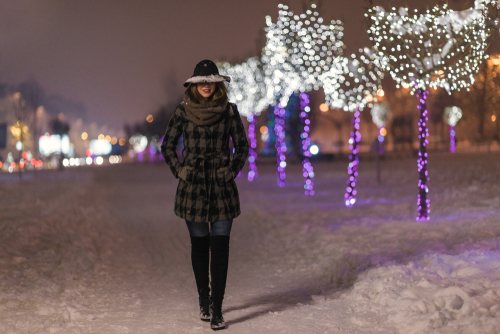 Woman walking in the snow at night