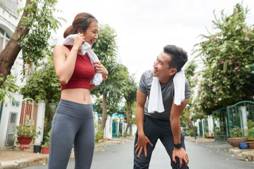 Couple sweating after a fitness walk or run