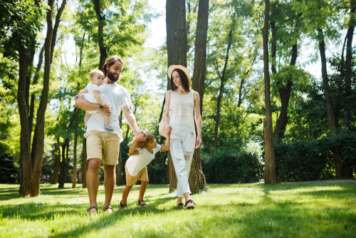 Happy family walking in a natural park setting