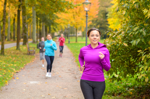 Women power walking in the park for fitness