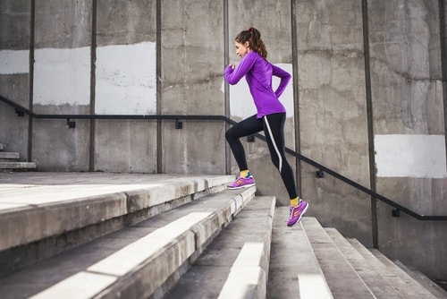 Woman climbing stairs to burn more calories