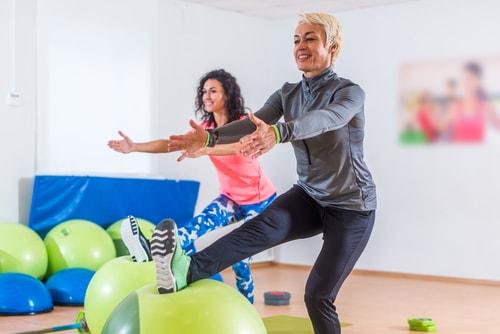 Woman doing a single leg balance on a balance ball
