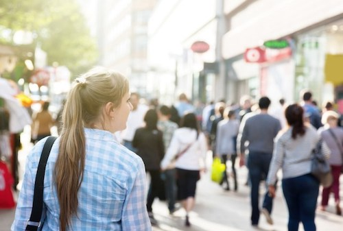 Woman walking in a crowded city street