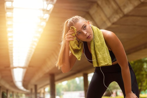 Woman taking a break after an intense workout