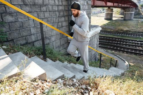 Man walking up stairs as an intense workout
