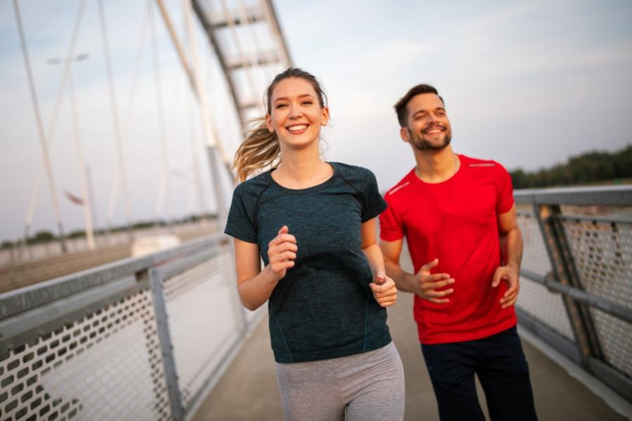 Couple walking for fitness on a bridge