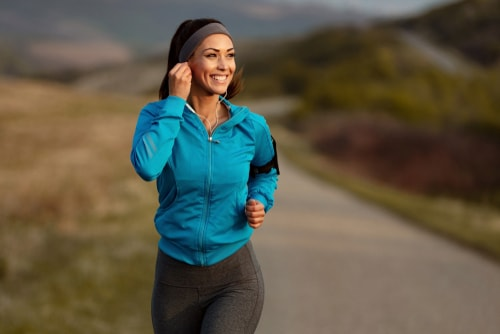 Woman going for a fitness walk in the countryside
