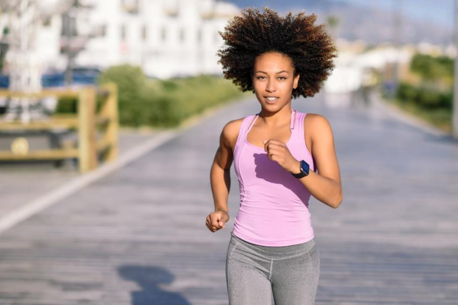 Sporty young woman power walking for fitness