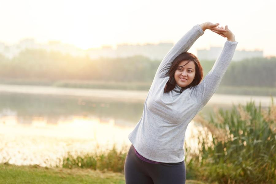 Woman stretching before a walk in the park