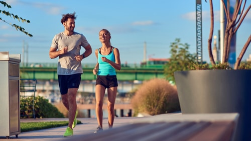 Couple walking for fitness in a city park