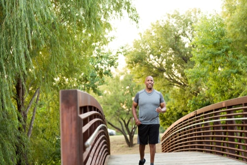 Man walking in park for fitness