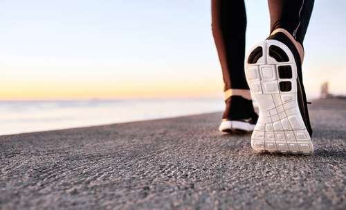 Athletic shoes hitting the pavement while walking