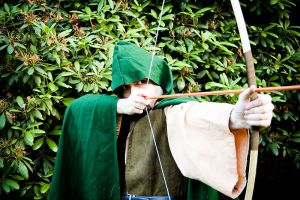 Robin Hood takes aim with a bow and arrow
