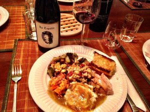 Tapatia Pinot Noir next to a plate of mashed sweet potato mash, gravy, turkey and cornbread stuffing