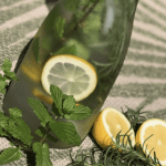 bottle of water with sliced lemons
