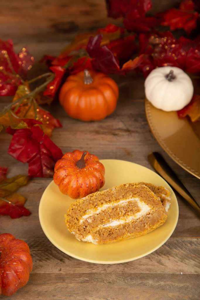 a slice of keto pumpkin roll
