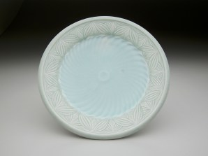"""Adam Field 6.5""""L x 6.5""""W x 1""""H reduction fired porcelain with carved pattern and various celadon glazes"""