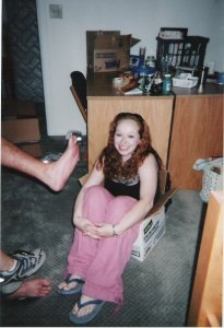 My first Facebook profile picture. Pink pants, random foot, college dorms. 2005.