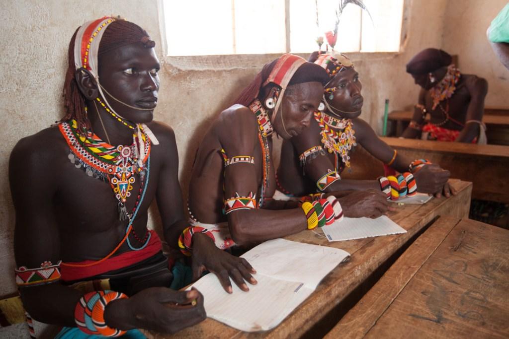 Samburu moran (warrior) learning to read | Photo by Nelson Guda © 2019