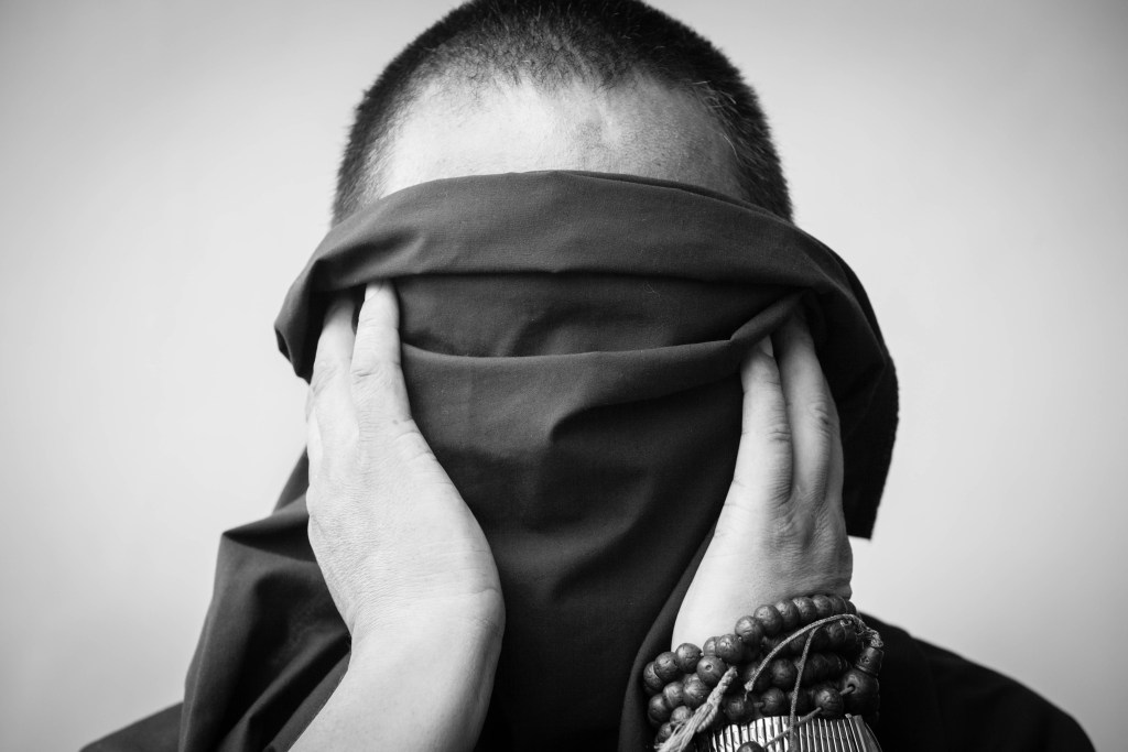 Tibetan monk refugee wanted to be photographed anonymously for fear of endangering his family.  | Photo by Nelson Guda © 2019