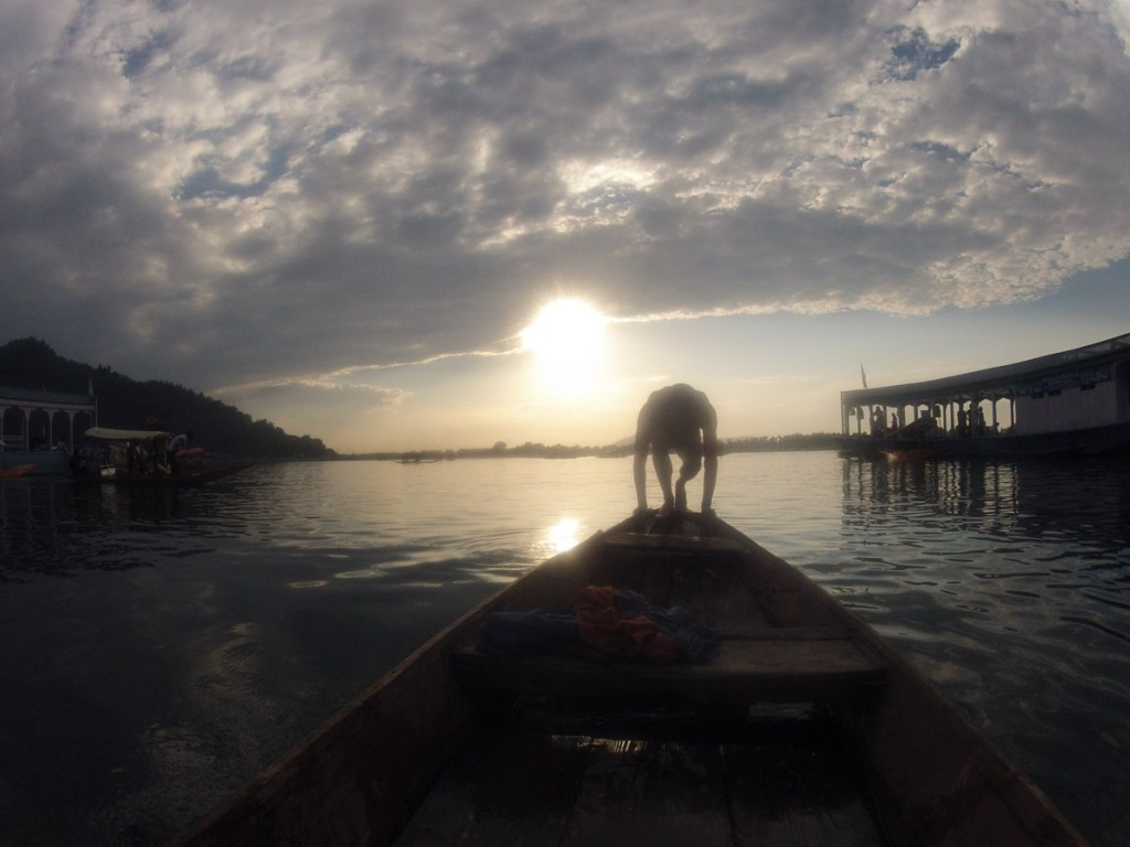 Diving off the Dongola's canoe into Dal Lake at sunset © Nelson Guda 2019