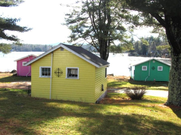 Yellow, pink, and green summer cottages at Harvey Lake near Portsmouth, NH.