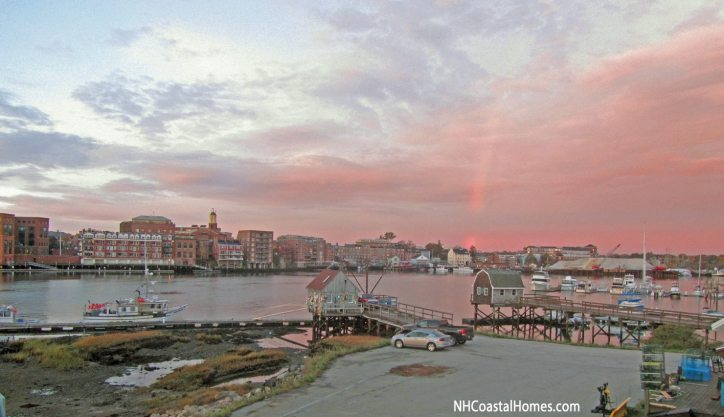 The view of Portsmouth Harbor with a rainbow and cloudy skies in the distance.