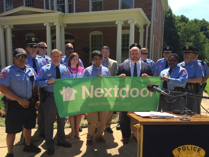 Nextdoor member Manish Lamba (center) and Nextdoor City Strategist Joseph Porcelli, flanked by officers from the Raleigh Police Department and Chief Deck-Brown (right)