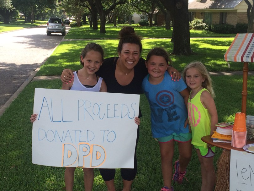 The girls with a supporter. All told, they raised over $10,000 for the Dallas Police Department.