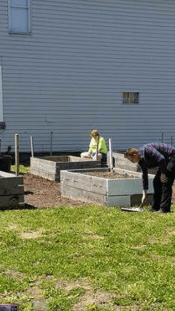 Sherri (left) helping set up some of the first plots for the community garden.