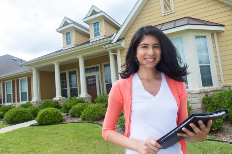 Nextdoor Real estate agent standing in front of new home