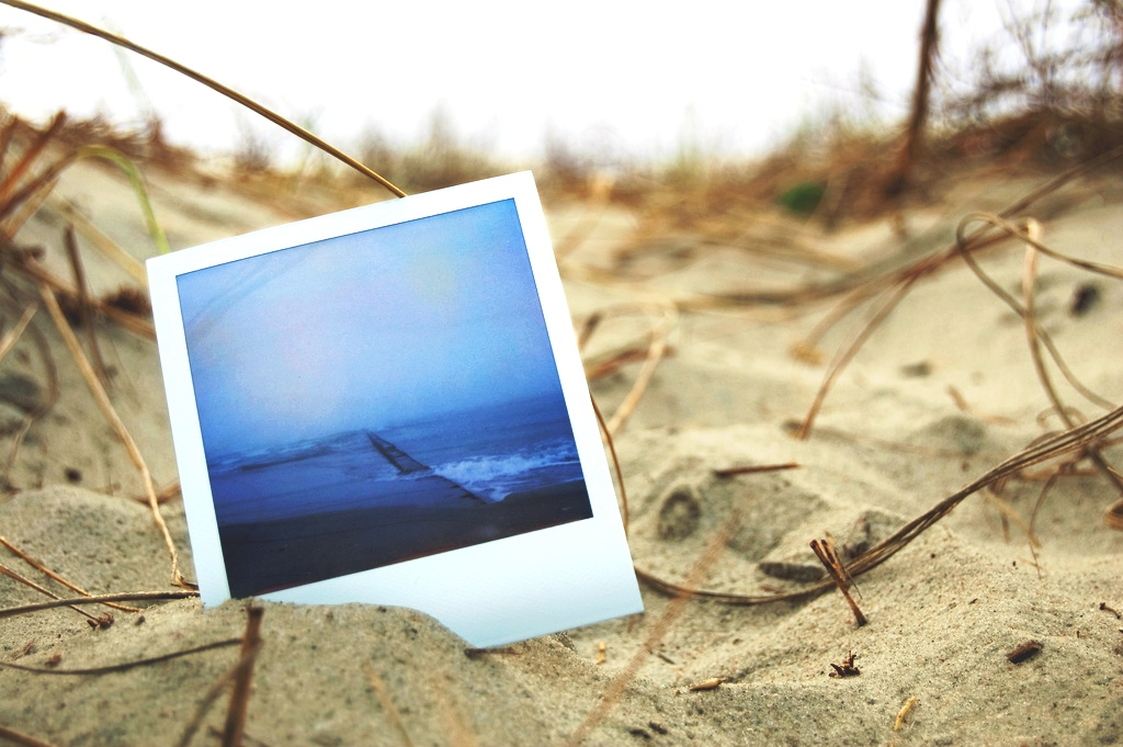 Polaroid photo in the sand