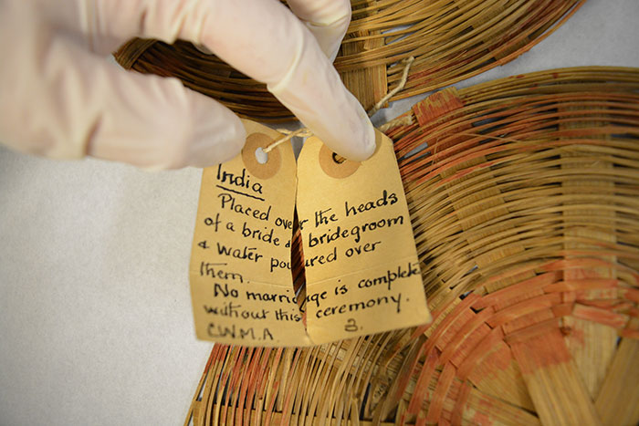 The label on the rattan discs explains that they were used in wedding ceremonies. © National Museums Scotland, 2016