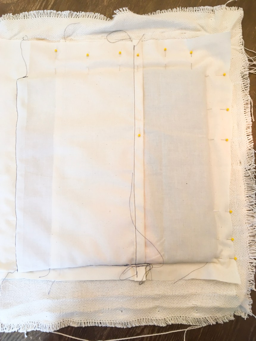 Sew close to the punch needle loops