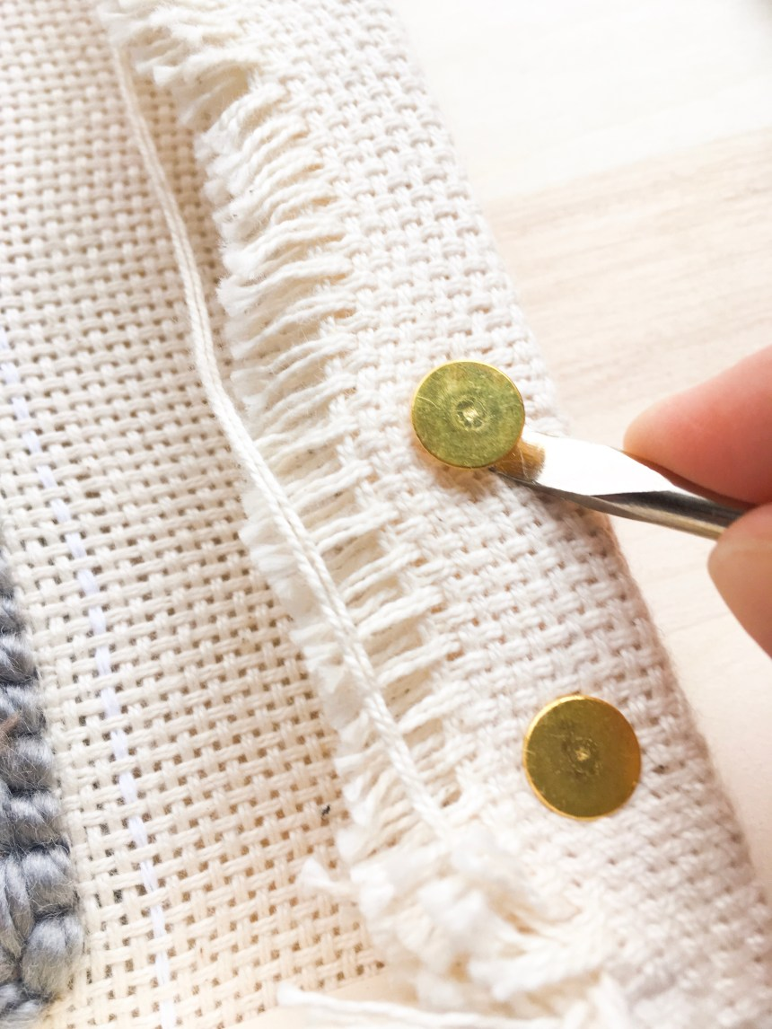 Remove the tacks from the punch needle frame