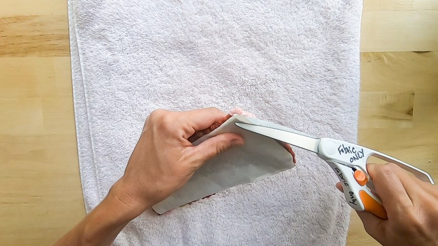 Trim any extra paper after adhesive paper has cooled