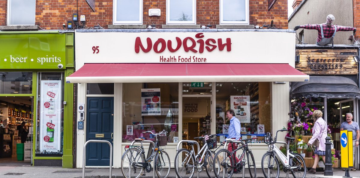 Nourish shop front in Sandymount with people and bicycles outside