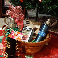 Insulated water bottles – one in a gift basket with tea and coffee and one wrapped with a coffee shop gift card.