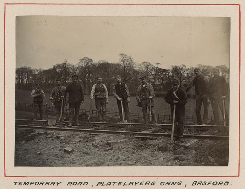 Navvies laying a temporary track at Basford