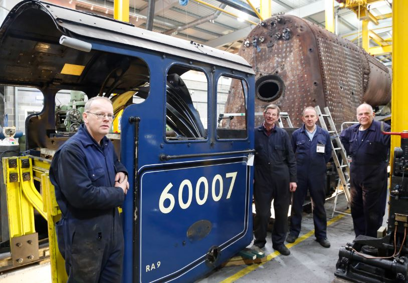 Darrin (left) with some of the Sir Nigel Gresley Locomotive Trust volunteers helping to overhaul the engine.