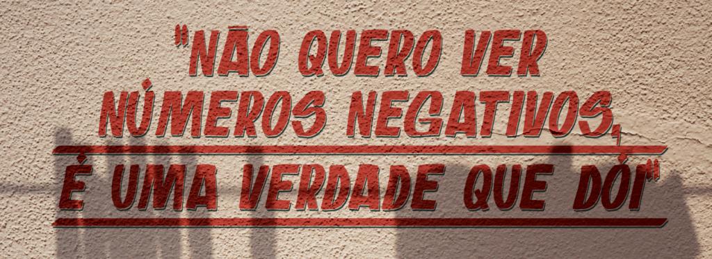 """Imagem de um muro onde está escrito """"Não quero ver números negativos, é uma verdade que dói"""""""