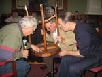 Simon Manchester and Peter Wedde examine and appraise a visitor's curios object