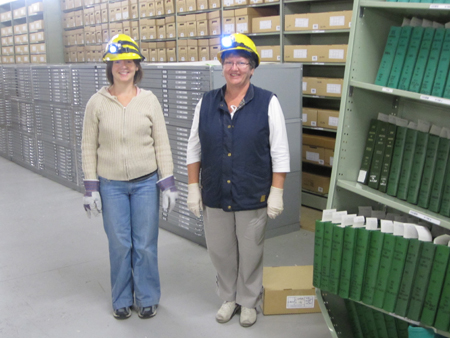 Archives staff dismantling shelving, March 2011.